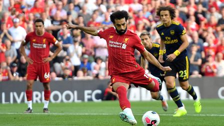 Liverpool's Mohamed Salah scores his side's second goal of the game from the penalty spot during the