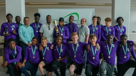 Textbook SA were triumphant in the u-15s tournament of the summer-long anti-crime football project.