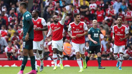 Arsenal's Alexandre Lacazette (centre) celebrates scoring his side's first goal of the game during t