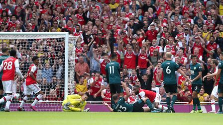 Arsenal's Alexandre Lacazette (centre right) scores his side's first goal of the game during the Pre