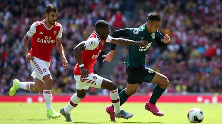 Arsenal's Ainsley Maitland-Niles (centre) and Burnley's Dwight McNeil battle for the ball during the