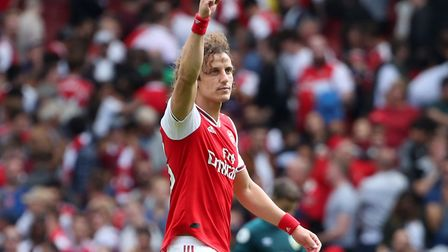 Arsenal's David Luiz gestures to fans after the Premier League match at The Emirates Stadium, London