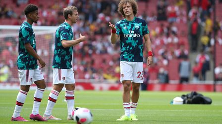 Arsenal's David Luiz (right) warms up prior to the Premier League match at The Emirates Stadium, Lon