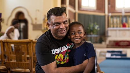 Tony Fernandes with Joziah Bignall, 4, who is one of the youngest members of the congregation at St