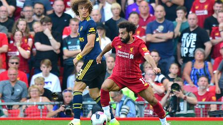 Arsenal's David Luiz (left) and Liverpool's Mohamed Salah battle for the ball during the Premier Lea