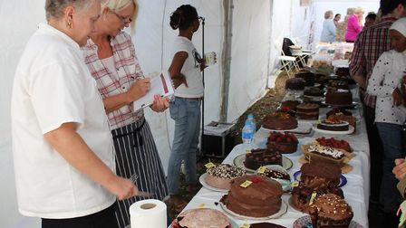 Judges at the cake stall at Queen's Park Day. Picture: City of London Corporation