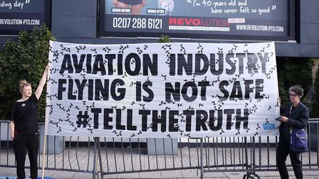 Extinction Rebellion activists involved in the Plane Truth performance outside Business Design Centr