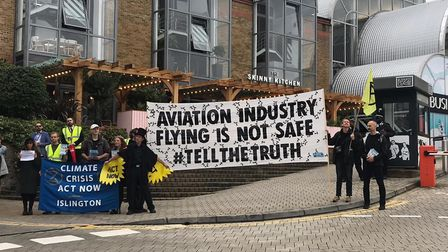 Extinction Rebellion Activtist outside the Islington Design Centre where the World Aviation is being