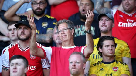 Arsenal fans in the stands react during the second half during the Premier League match at Vicarage