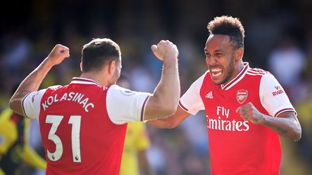 Arsenal's Pierre-Emerick Aubameyang (centre) celebrates scoring his side's first goal of the game wi