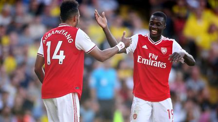 Arsenal's Pierre-Emerick Aubameyang (left) celebrates scoring his side's second goal of the game wit