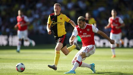 Watford's Will Hughes (left) and Arsenal's Sead Kolasinac in action during the Premier League match
