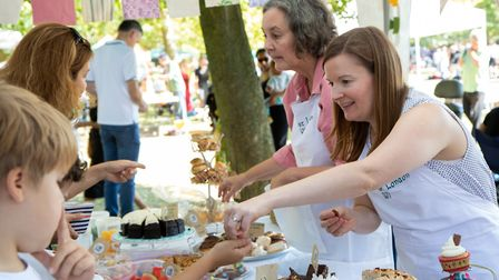 Members of the Women's Institute serve cakes. Picture: Jonathan Goldberg