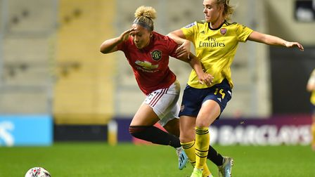 Manchester United's Lauren James is tackled by Arsenal's Jill Roord during the Barclays FA Women's S