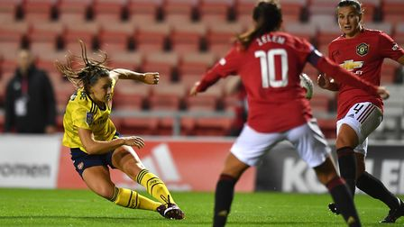 Arsenal's Lisa Evans has a shot on goal during the Barclays FA Women's Super League match at Leigh S