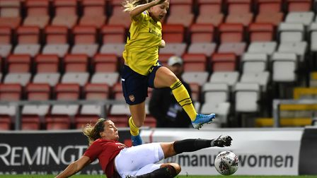 Arsenal's Beth Mead (top) avoids a challenge from Manchester United's Amy Turner during the Barclays