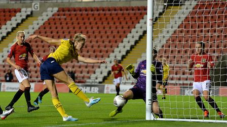 Arsenal's Vivianne Miedema sees her shot on goal saved by Manchester United's goalkeeper Mary Earps