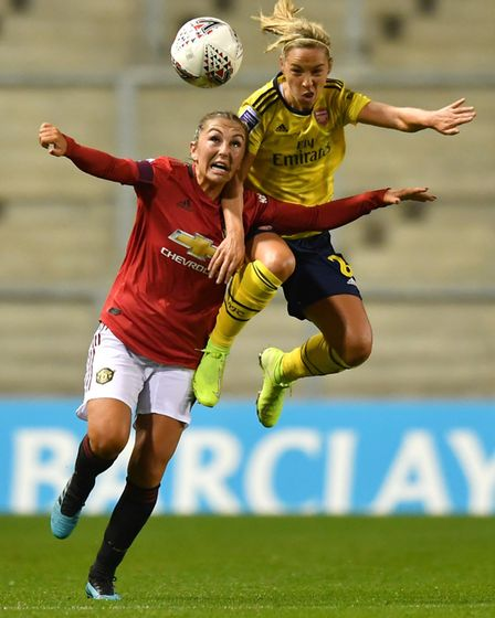Arsenal's Jordan Nobbs (right) and Manchester United's Katie Zelem battle for the ball during the Ba