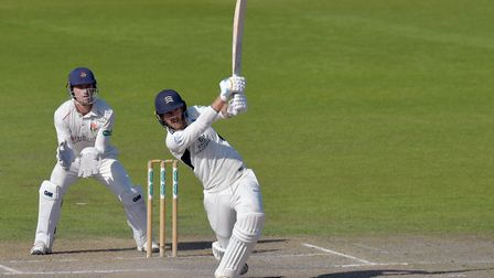 Middlesex's James Harris hits a boundary during day four of the Specsavers County Championship Divis
