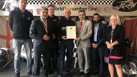 Ace Cafe founder Mark Wilsmore awarded a certificate of appreciation by Brent Council and a 'Red Whe