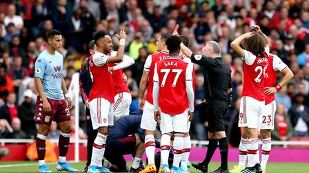 Arsenal's Ainsley Maitland-Niles is shown a red card by Referee Jon Moss during the Premier League m