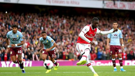 Arsenal's Nicolas Pepe (second right) scores his side's first goal of the game from the penalty spot