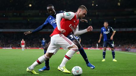 Arsenal's Calum Chambers takes on Nottingham Forest's Albert Adomah during the Carabao Cup, Third Ro