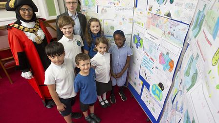 Pupils from Thornhill Primary School with their climate change posters, which were put on display at