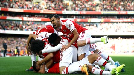 Arsenal's David Luiz celebrates scoring his sides first goal of the game with teammates during the P