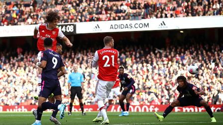 Arsenal's David Luiz scores his side's first goal of the game during the Premier League match at the