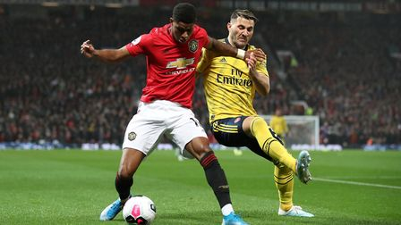 Manchester United's Marcus Rashford and Arsenal's Sead Kolasinac battle for the ball during the Prem