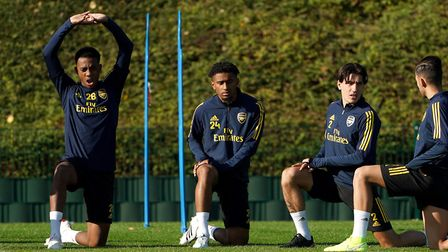 (left to right) Arsenal's Joe Willock, Reiss Nelson and Hector Bellerin during the training session