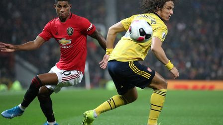 Manchester United's Marcus Rashford and Arsenal's David Luiz during the Premier League match at Old