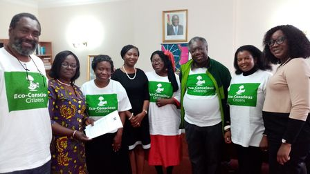 Awula Serwah (third left) and her Eco-Conscious Citizens group present a petition to the Ghanaian Hi