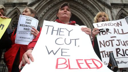 Stock image of protesters against the bedroom tax outside the Royal Courts of Justice in London. Pi