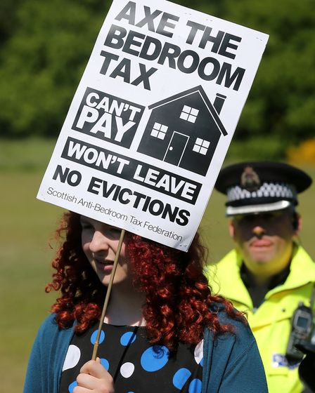 Stock image of a protester at an Anti-Bedroom Tax rally. Picture: Andrew Milligan/ PA Images