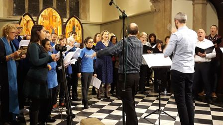 The Met Police choir and the Kith and Kids choir practicing for the show.