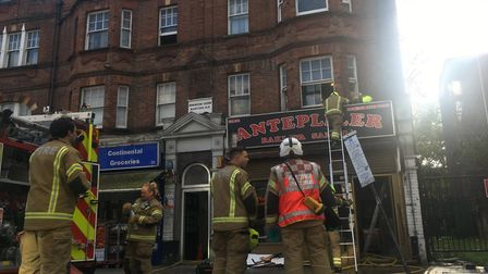 Firefighters on the scene in Green Lanes. Picture: Lucas Cumiskey