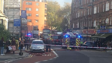 Firefighters at the scene in Green Lanes. Picture: Lucas Cumiskey