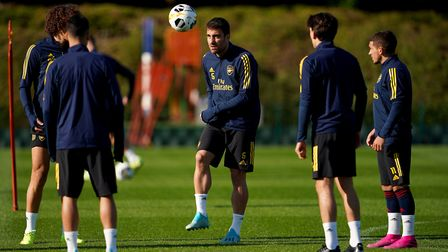 Arsenal's Sokratis Papastathopoulos (centre) during a training session at London Colney (pic Tess De
