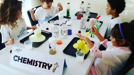 A group of children get stuck into chemistry at Little Scientists Club. Picture: LSC