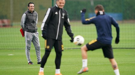 Arsenal manager Unai Emery (left) during a training session at London Colney, London. Picture: John