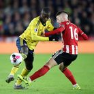 Arsenal's Nicolas Pepe (left) and Sheffield United's Oliver Norwood battle for the ball during the P