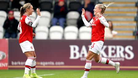 Arsenal Women's Beth Mead (right) celebrates scoring their third goal of the game with teammate Jord