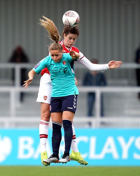 Arsenal women's Jennifer Beattie battles for possession of the ball in the air with Charlton Athleti