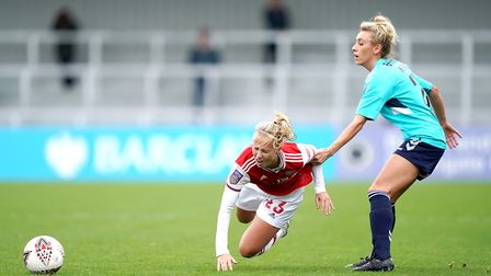 Arsenal women's Beth Mead goes down under the challenge of Charlton Athletic women's Charlotte Kerr