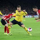 Arsenal's Calum Chambers (centre) battles with Sheffield United's Oliver Norwood (left) and Enda Ste