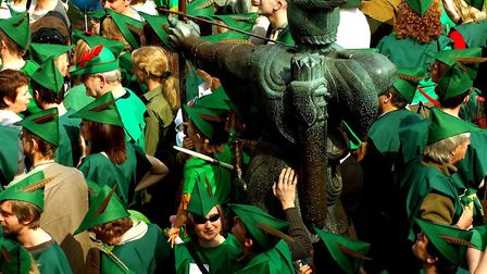 A crowd of over 100 people dressed as English folk hero Robin Hood gather for a Guiness Book of Worl