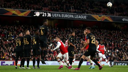 Arsenal's Nicolas Pepe (right) scores his side's second goal of the game during the UEFA Europa Leag