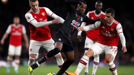 Arsenal's Calum Chambers (left) and Granit Xhaka (right) battle for the ball with Crystal Palace's W